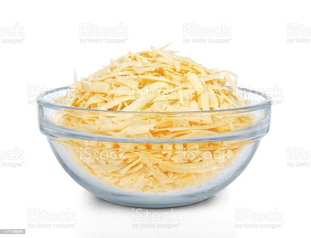 Glass bowl of grated cheese stock photo