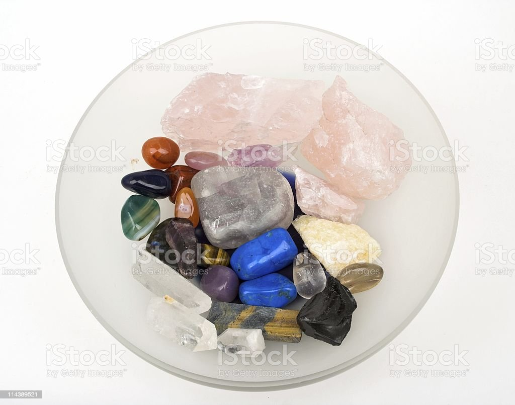 Glass Bowl Of Healing Crystals stock photo