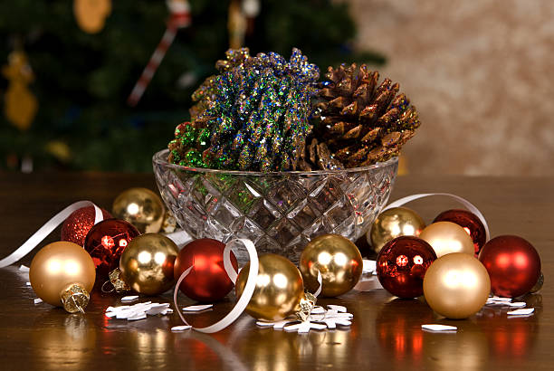 Glass Bowl of Pine Cones Covered with Glitter stock photo