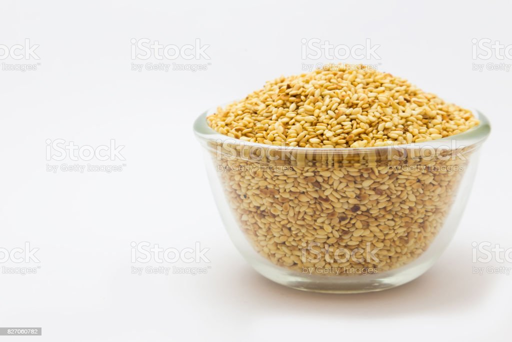 Glass bowl of sesame seeds stock photo