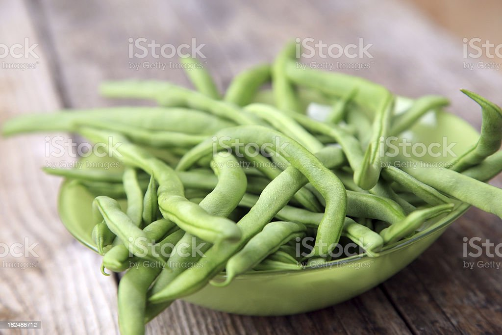 Glass bowl with green beans stock photo