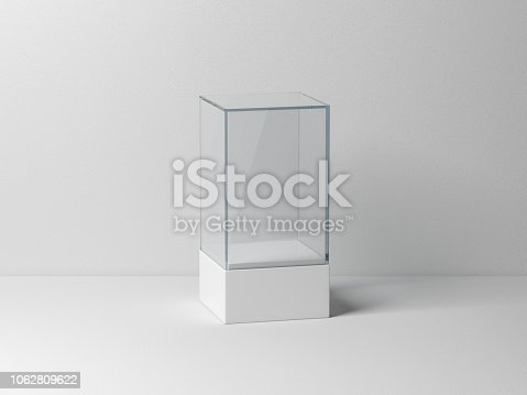 istock Glass box Mockup with white podium for product presentation 1062809622