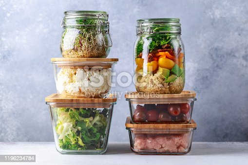 istock Glass boxes and cans with fresh food refrigerator storage concept decanting 1196234784