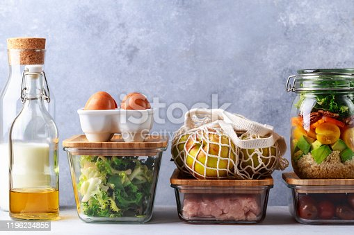 istock Glass boxes and cans with fresh food refrigerator storage concept decanting 1196234855