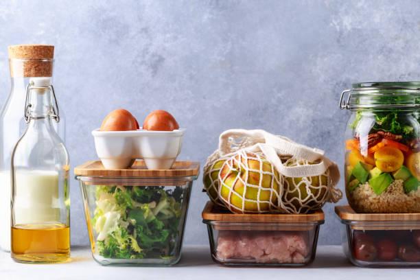 glass boxes and cans with fresh food refrigerator storage concept decanting - comida sustentavel imagens e fotografias de stock
