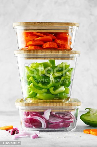 Glass boxes with fresh raw vegetables. Healthy Meal Prep - recipe preparation photos. Healthy vegan dishes in glass containers. Weight loss food concept
