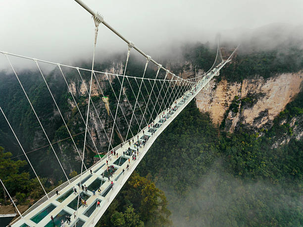 glass bridge of zhangjiajie china - bridge stok fotoğraflar ve resimler