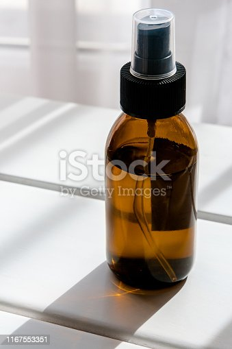 1167558793 istock photo Glass brown bottles with organic cosmetics 1167553351