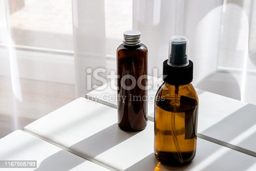 1167558793 istock photo Glass brown bottles with organic cosmetics 1167558793