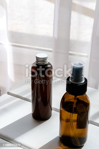 1167558793 istock photo Glass brown bottles with organic cosmetics 1168912370