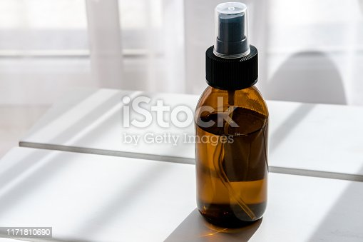 1167558793 istock photo Glass brown bottles with organic cosmetics 1171810690