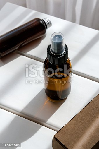 1167558793 istock photo Glass brown bottles with organic cosmetics 1179047921