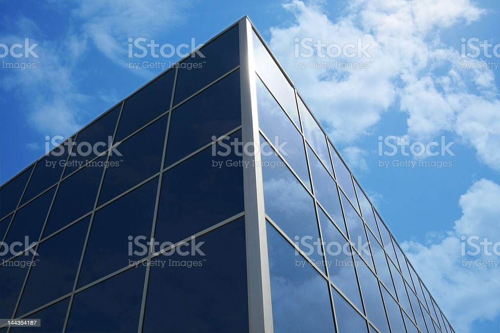 Glass building reflections of clouds royalty-free stock photo