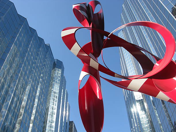 Glass buildings with Red and White Sculpture, Oklahoma City, Oklahoma stock photo