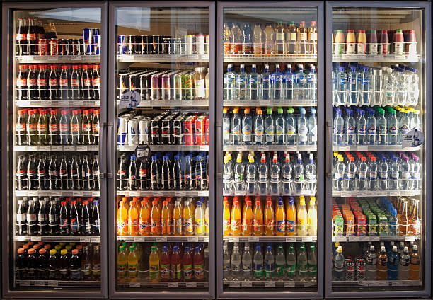 glass cabinets with diverse range of softdrinks. - soda pop stock photos and pictures