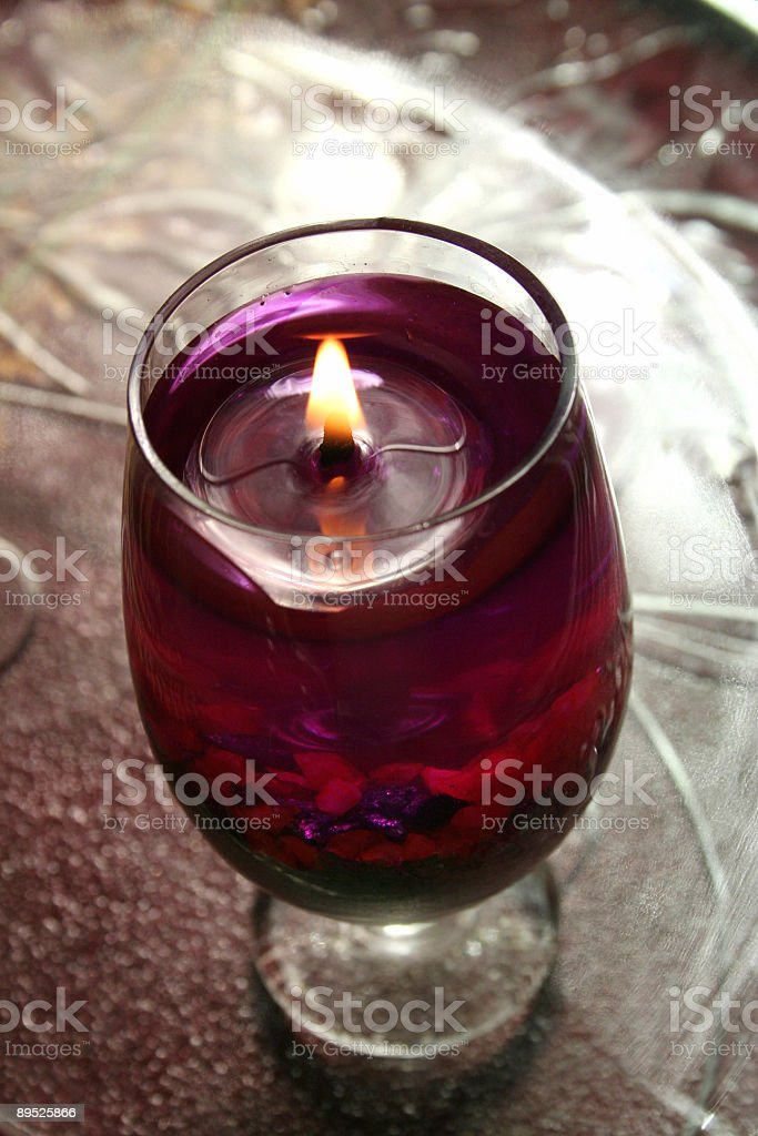 Glass candle royalty-free stock photo