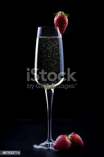 istock glass champagne black background 667633714