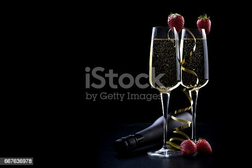 istock glass champagne black background 667636978