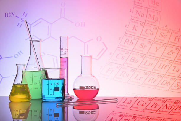 glass chemical containers colorfull with representation background - beaker stock photos and pictures