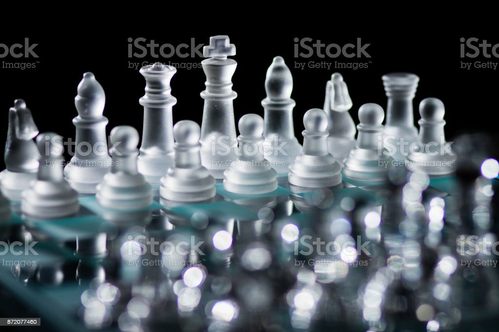 Glass Chess Board With Pieces Set Up And Ready For A Game Against A
