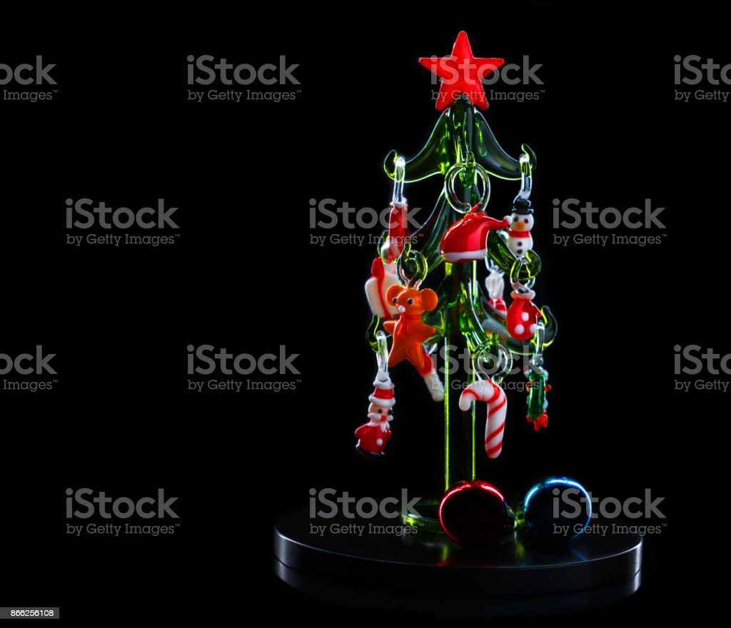 glass christmas tree with christmas decorations on dark background royalty free stock photo