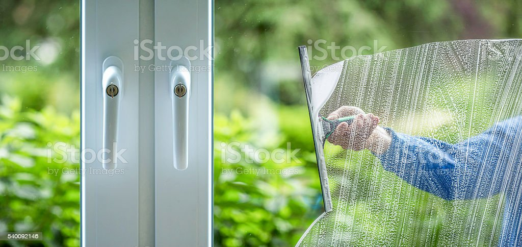 Glass cleaning - housework stock photo
