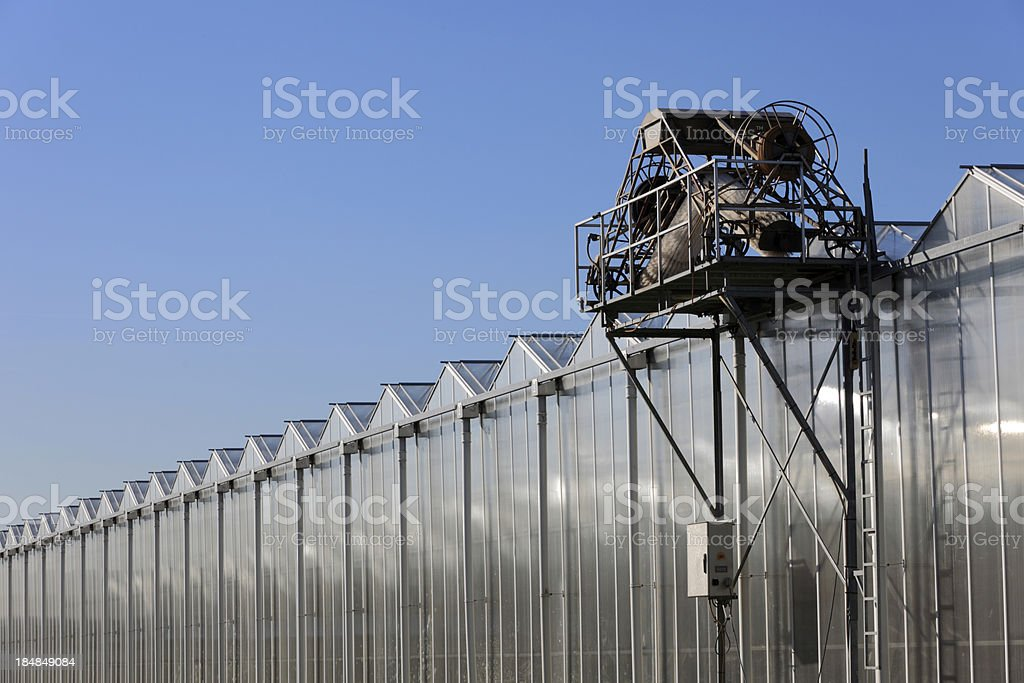 glass cleaning machine on top of a greenhouse royalty-free stock photo