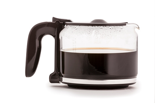 Glass Coffee Carafe isolated  with hot coffee