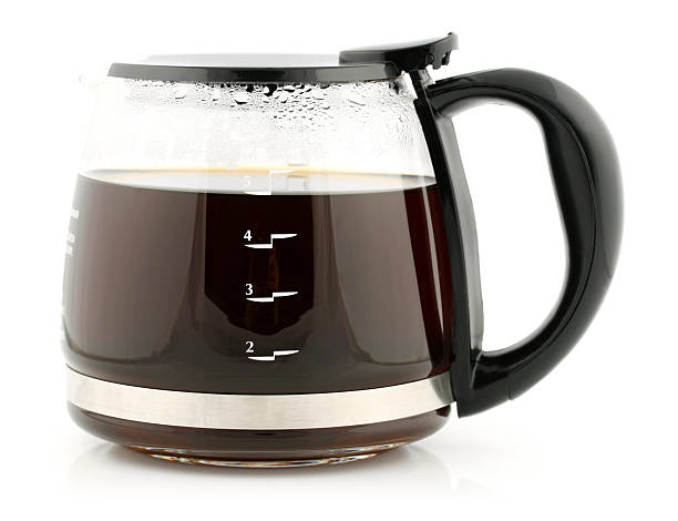 Glass Coffee Carafe A glass coffee carafe full of 5 cups of coffee. coffee pot stock pictures, royalty-free photos & images