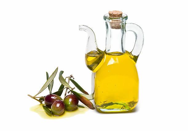 Recipiente de vidrio y aceite de oliva. - foto de stock