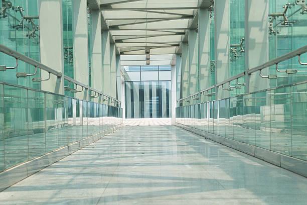 glass corridor in office centre stock photo