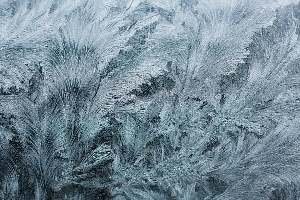 glass covered with ice during the severe frosts in winter - acquaforte foto e immagini stock