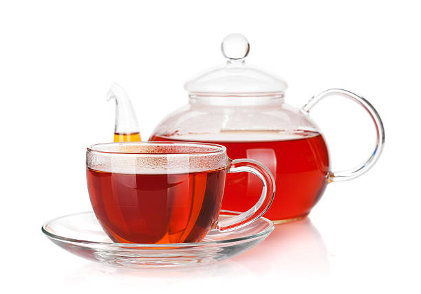 Glass cup and teapot of black tea stock photo