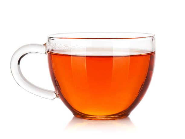 glass cup of black tea - theekop stockfoto's en -beelden