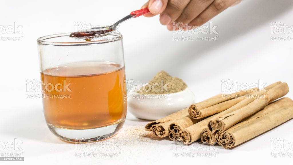 Glass cup of Cinnamon and Licorice stock photo