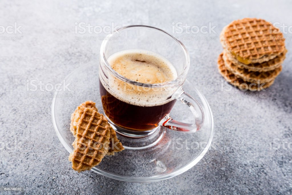 Glass cup of coffee with amaretti cookies stock photo