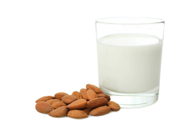 Glass cup of milk and almond nuts stock photo