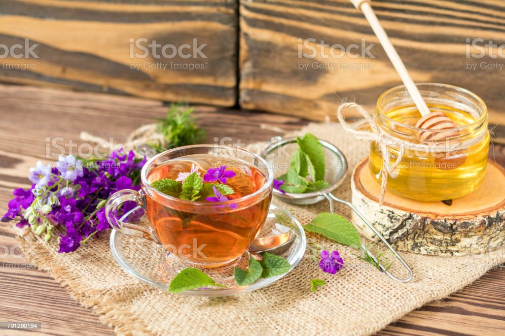 Glass cup of summer tea with herbs royalty-free stock photo
