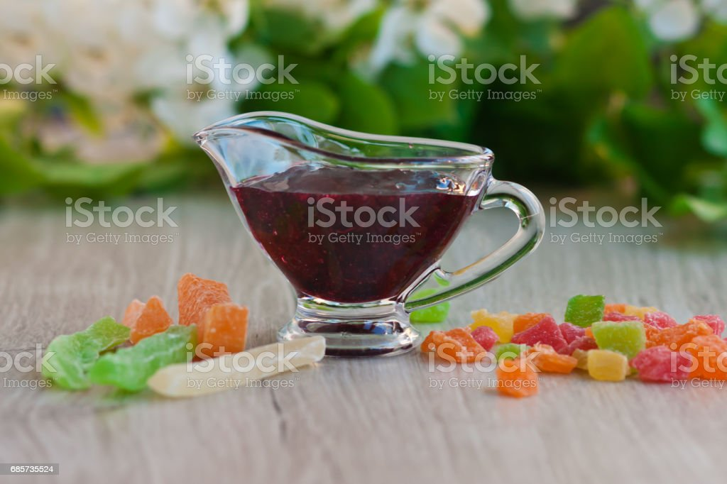 Glass cup with jam and a little candied fruit foto de stock royalty-free
