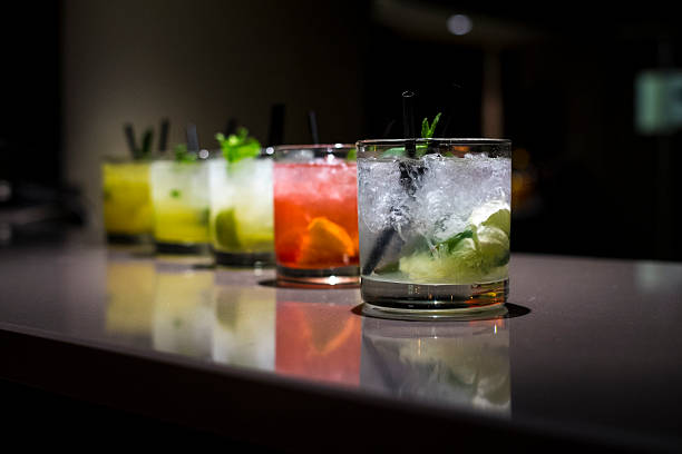 Glass cups filled with different flavored mojitos stock photo