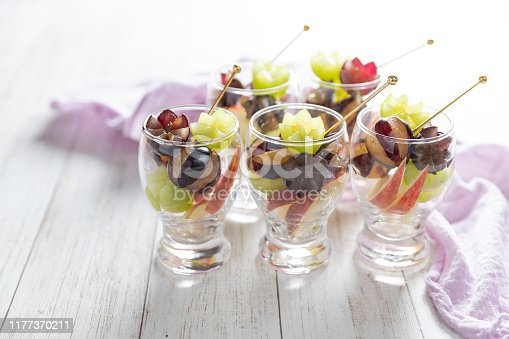 Glass cups filled with ripe juicy grapes