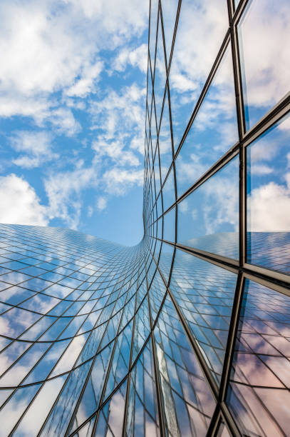 glass curved building and blue sky - architecture and buildings stock pictures, royalty-free photos & images