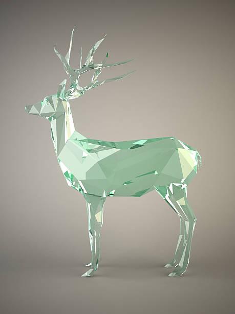 glas deer konzept auf grauem hintergrund. - glasskulpturen stock-fotos und bilder