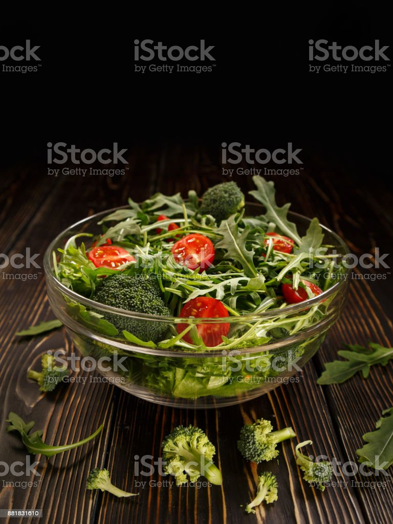 Glass dish with organic salad from vegetables and greens stock photo