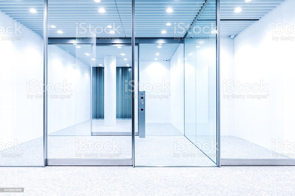 glass door with hi-tech fingerprint lock in modern building stock photo