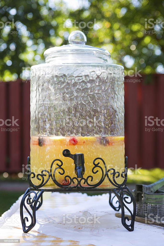 Glass drink dispenser with fruit punch royalty-free stock photo