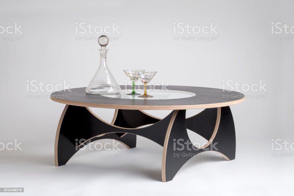 Glass Drinking Set on Black Designer Round Table stock photo
