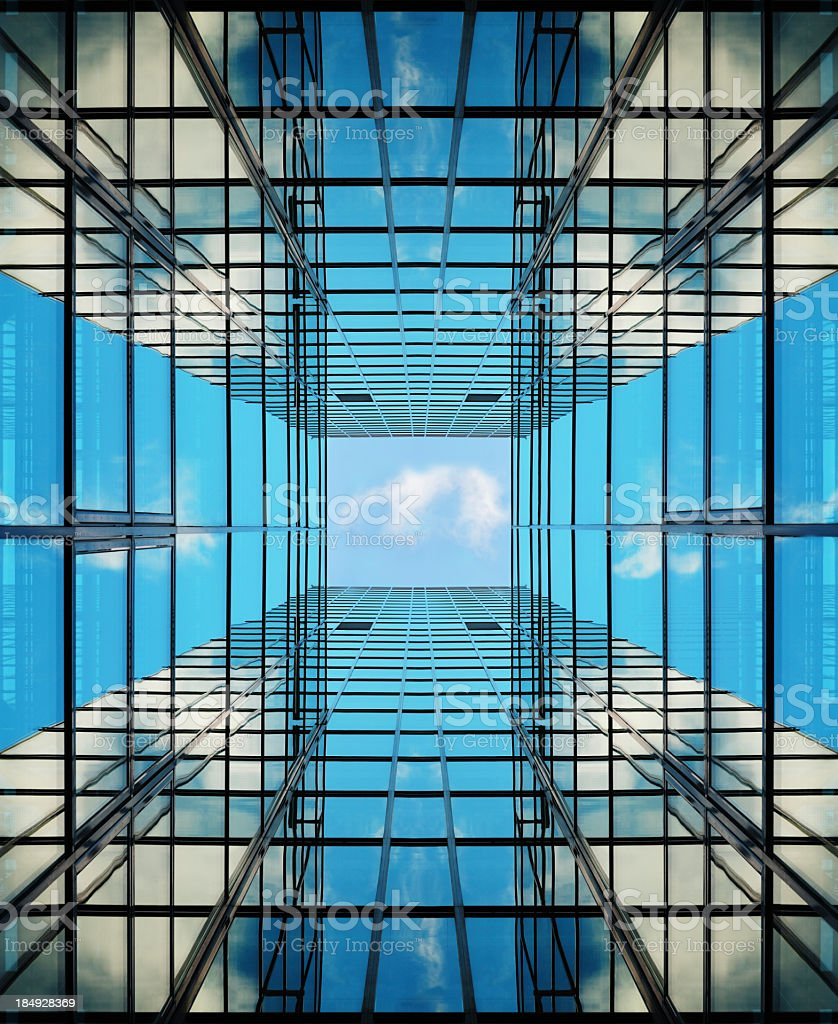 Glass facade building seen from below, copy space stock photo