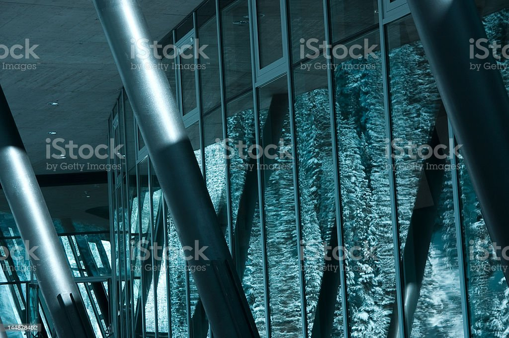 glass facade with snow mountain reflection royalty-free stock photo