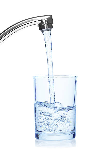 glass filled with drinking water from tap. - tap water stok fotoğraflar ve resimler